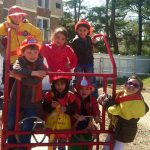 A group of children play firemen.