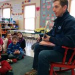 WJAR10's Mark Searles reads to the children.