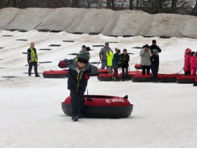 Boy pulls his tube at a snow tubing facility.